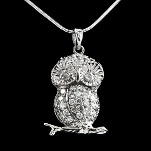 This sweet little owl is sitting on a branch and nicely decorated with cubic zirconium.