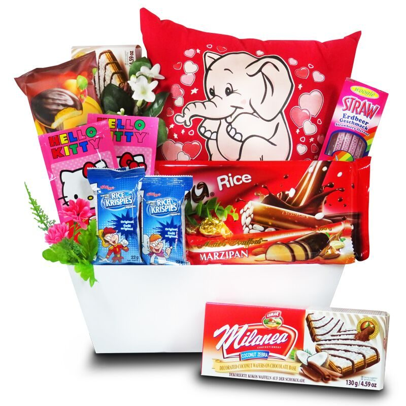 Birthday Gift for Children, glow pillow with chocolates and sweets in a basket.