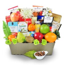 Large fruit basket with cheeses, cookies juice, and cookies.